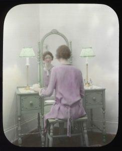 Woman_at_mirror,_circa_1930s