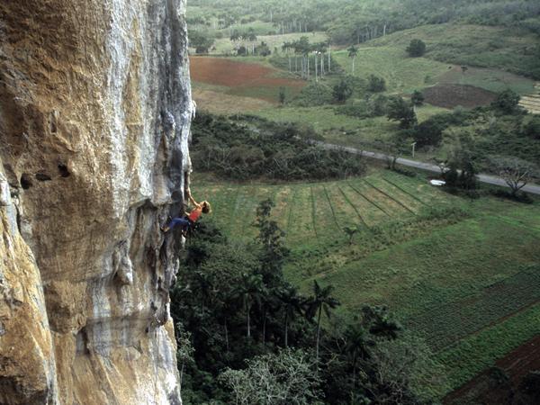 Climbing on limestone cliffs in Viñales Valley, Piñar del Rio Province, Cuba