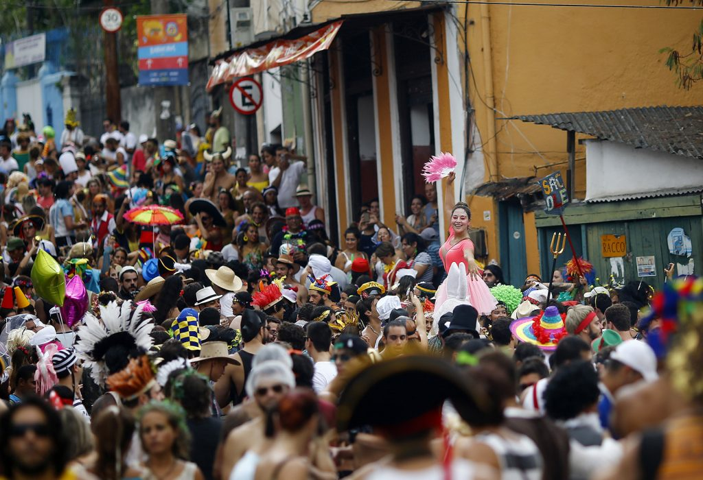 "Revellers take part in an annual block party known as ""Ceu na Terra"" (Heaven in Earth), one of the many carnival parties to take place in the neighbourhoods of Rio de Janeiro"