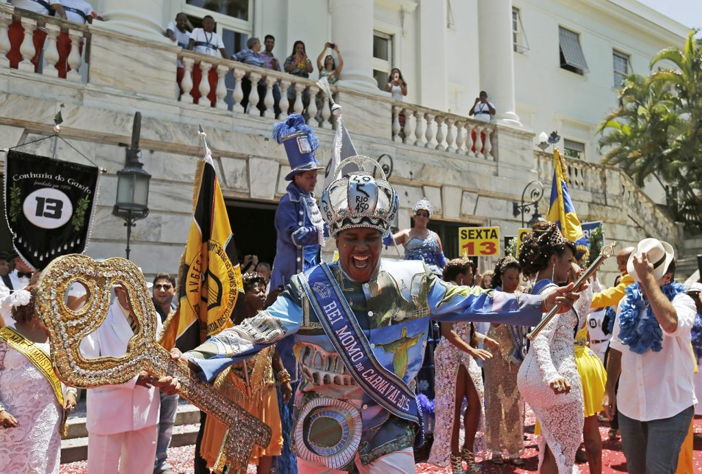 The Rei Momo, or Carnival King Wilson Neto dances during the handing over of the ceremonial key to the city, at Cidade Palace in Rio de Janeiro